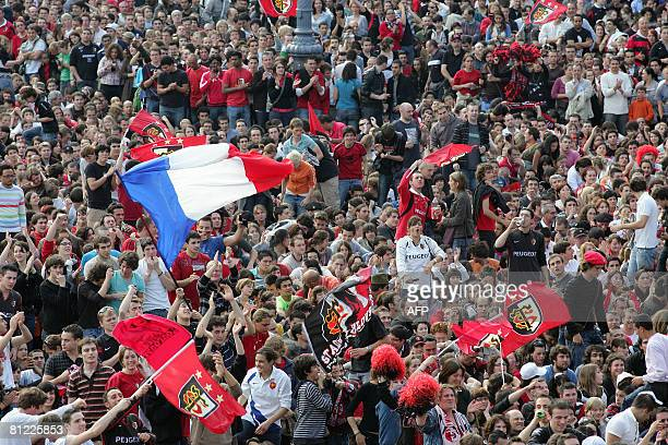Some 20000 fans cheer up their Toulouse rugby team as they attend on a giant screen at the Capitole's square in Toulouse southwestern France on May...