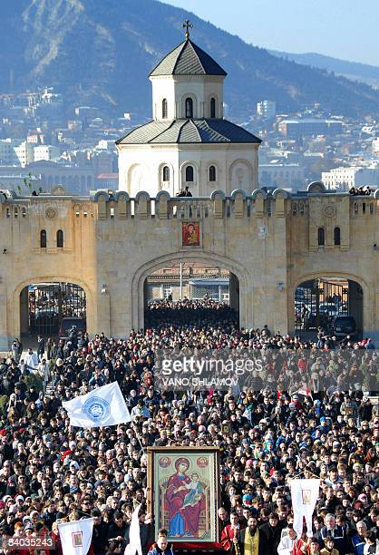 Some 20000 Georgian Orthodox believers carry on December 14 2008 a icon for Patriarch Ilya II in celebration of the 31st anniversary of his...