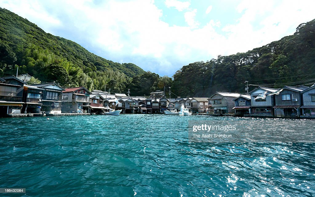 Some 230 'Funaya' boathouses are arranged at Ine Bay on October 17, 2013 in Ine, Kyoto, Japan. The traditional boathouses' ground floor is used as the place to load and unload the staffs directly from boats and the first floor is used as living space.