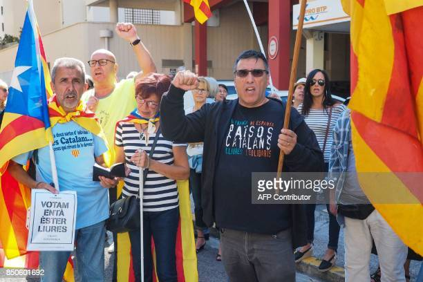 Some 300 people demonstrate in front of the Spanish Consulate in Perpignan southern France on September 21 2017 to protest against the arrests of a...