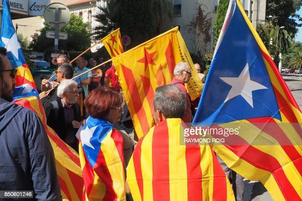 Some 300 people demonstrate with Catalan proindependence 'estelada' flags in front of the Spanish Consulate in Perpignan southern France on September...