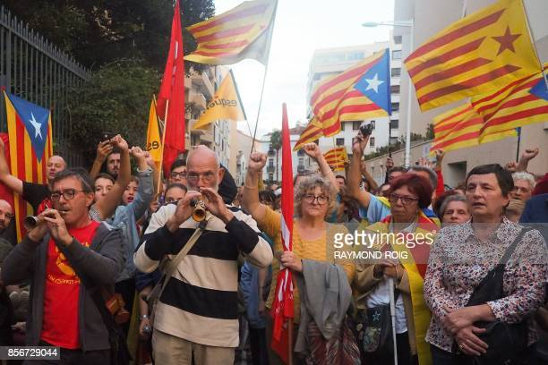 Some 500 people waving the Catalan flag demonstrate outside the Spanish Consulate in Perpignan on October 2 2017 to protest against police violence...
