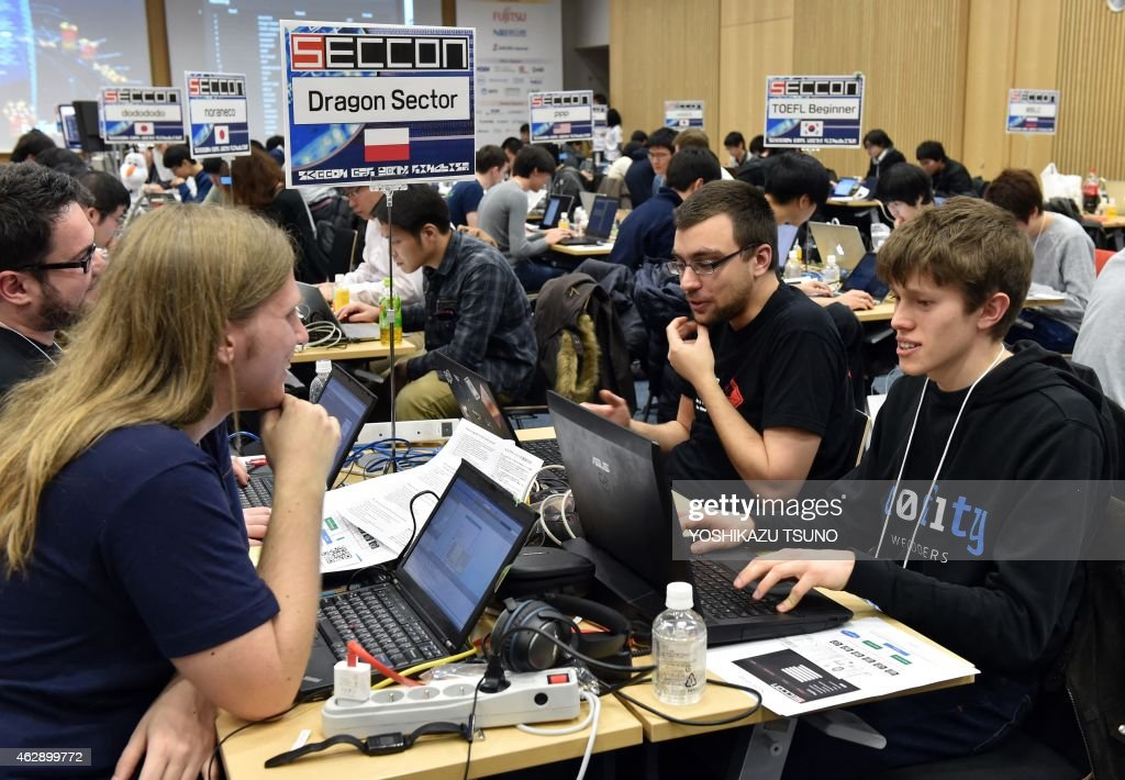 Some 90 participants in 24 teams from seven nations and regions from China, Japan, Poland, Russia, South Korea, Taiwan, and the United States compete in their hacking skills at the final rounds of the Security Contest 2014, SECCON on February 7, 2015. A cyber security competition began in Tokyo, with organisers aiming to show off the skills of young Japanese hackers by seeing how they fare against foreign rivals. AFP PHOTO / Yoshikazu TSUNO