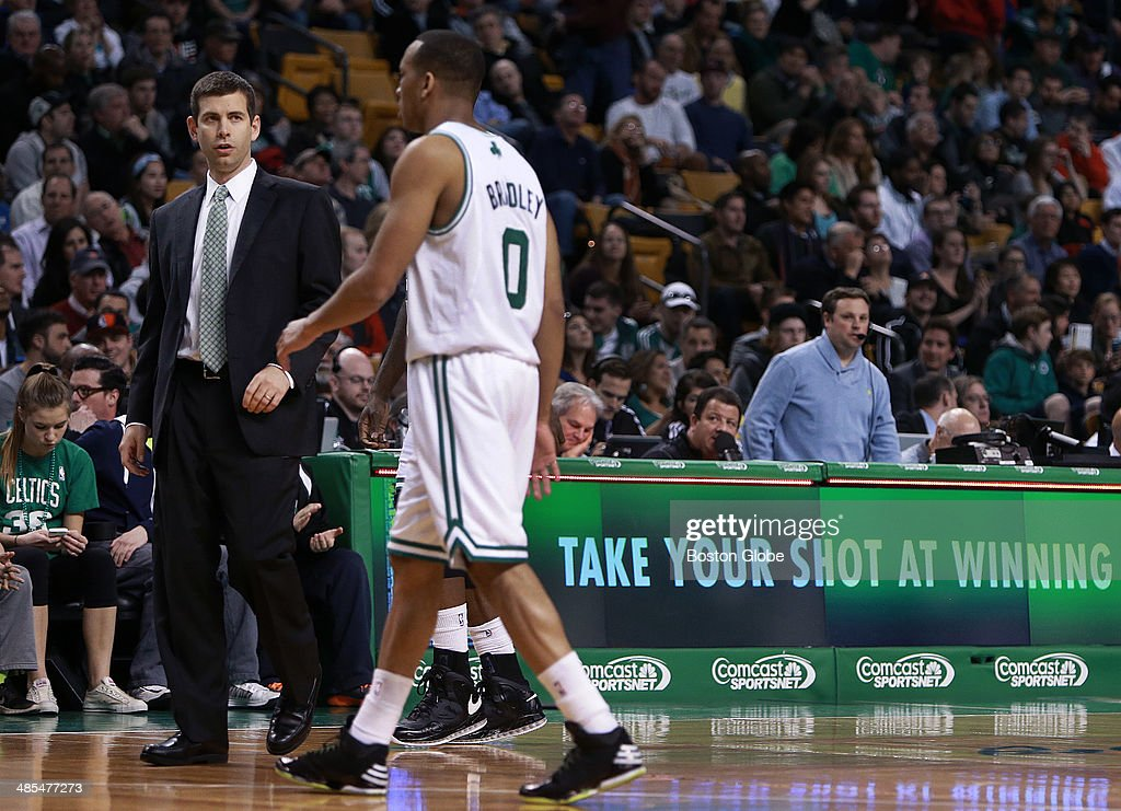 Some appropriate signage is visible as Celtics Head Coach Brad Stevens watches Avery Bradley come off the floor in the first half. The Boston Celtics hosted the Washington Wizards in their final NBA game of the season at the TD Garden on Wednesday, April 16, 2014.