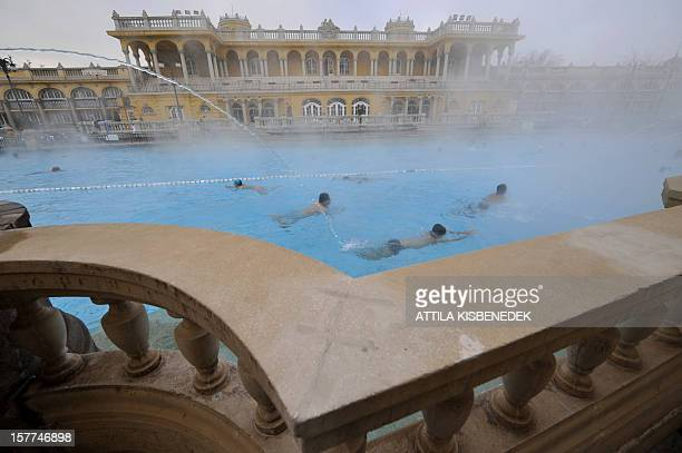 Some bathers relax in the pool of steaming hot water in the Széchenyi Thermal Bath the one of the largest spa complexes in Europe on December 30 2008...