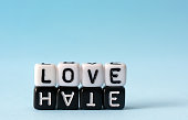 Love and Hate text concept  on white and black dices