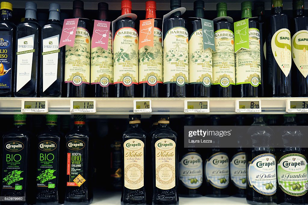 Some bottles of Italian oil that like other Italian products could become more expensive or difficult to find for England after the Brexit referendum are displayed in a supermarket on June 25, 2016 in the town of Nola near Naples, Italy. The results from the historic EU referendum has been declared and the United Kingdom has voted to leave the European Union.
