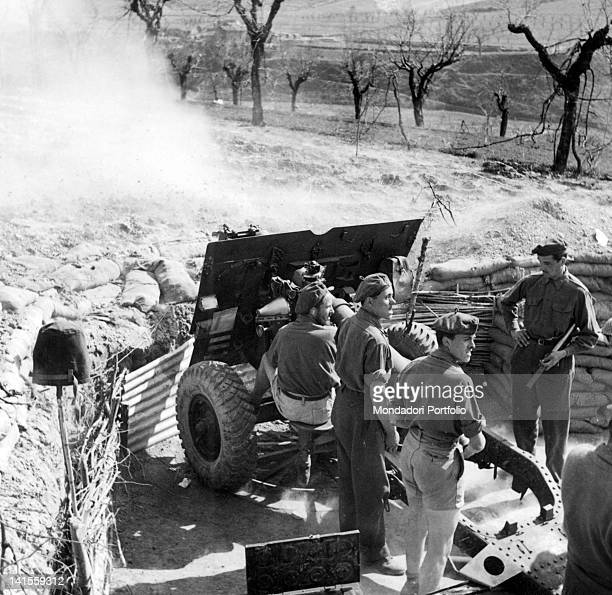 Some British soldiers firing a 25pound gun seized from the Italian units operating in Sicily Ancona July 1944