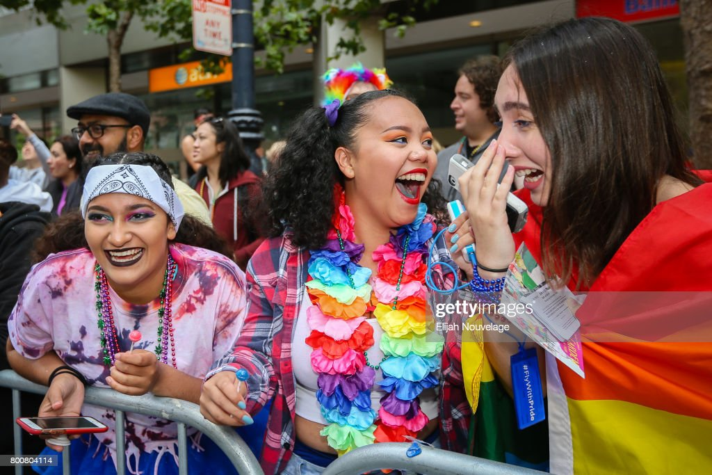 Some bystanders become excited after seeing one of the stars of the Netflix series '13 Reasons Why' at the annual LGBTQI Pride Parade on June 25, 2017 in San Francisco, California.