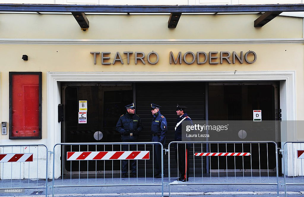 Some Carabinieri and men of Guardia di Finanza stand outside the Teatro Moderno where the hearing in the trial of the Costa Concordia takes place on December 9, 2013 in Grosseto, Italy. Coastguard Captain Gregorio De Falco and Captain Francesco Schettino met for the first time in court today. De Falco, famous for ordering Schettino back onboard after he allegedly abandoned the ship with hundreds of passengers still onboard, took to the stand as a witness. The Costa Concordia capsized on January 13, 2012 leaving 32 people dead.