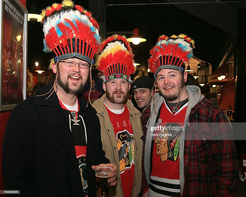 Some Chicago Blackhawks fans pose for a picture in the concourse of Joe Louis Arena before an NHL game against the Detroit Red Wings on March 3, 2013 in Detroit, Michigan.