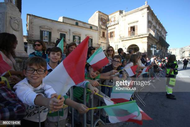 Some children celebrate in Modica Sicily southern Italy while they are waiting for Prince Albert II of Monaco