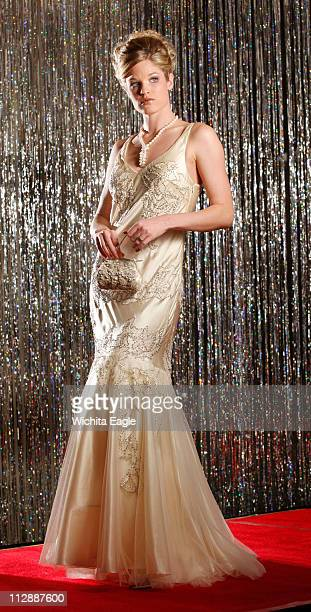Some dresses are showstoppers Heads turn and the dress is remembered long after it's been hung back in the closet This winter white evening gown is...