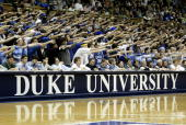 Some Duke Blue Devil students gesture towards the Wake Forest Demon Deacons bench on February 20 2005 at Cameron Indoor Stadium in Durham North...