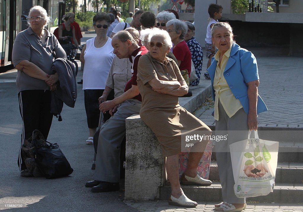 Some elderly people wait for the evacuation in Szekesfehervar, about 60 km west from the Hungarian capital Budapest on July 18, 2013 as the police began evacuating around 10,000 people in the central city of Szekesfehervar after a World War II bomb was discovered next to a kindergarten.