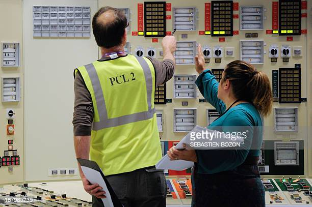 Some employees of EDF a French electric utility company work in a control room simulator at the Fessenheim nuclear powerplant during a nuclear...