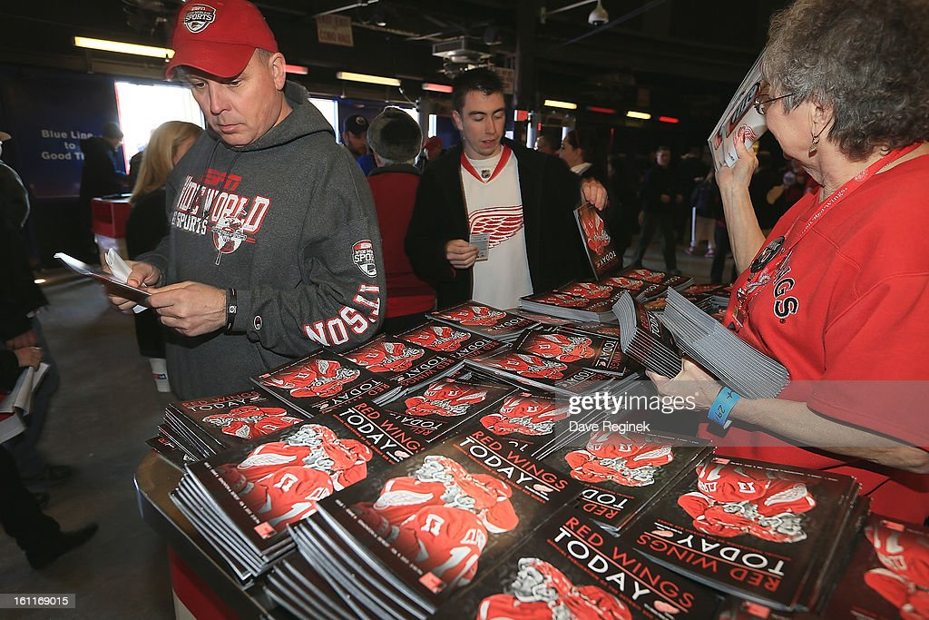 Some fans grab a free program before a NHL game between the Edmonton Oilers and the Detroit Red Wings at Joe Louis Arena on February 9, 2013 in Detroit, Michigan.