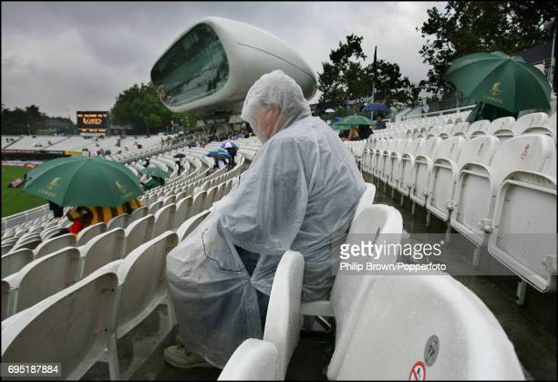 Some fans waiting for the rain to stop during the 1st Ashes Test match between England and Australia at Lord's Cricket Ground in London on the 24th...