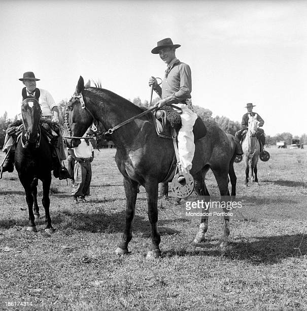 Some gauchos on horseback they are the typical South American cattlemen the equivalent of North American cowboys found in the pampas in parts of...