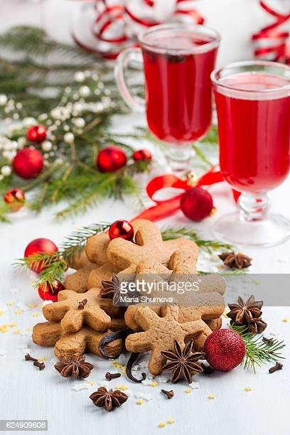 Some gingerbread cookies with festive decorations and mulled wine