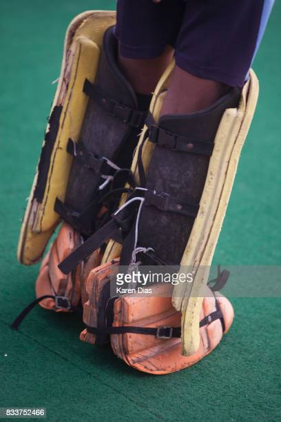 Some hockey equipment is supplied to the academy from the government but most of it is dated and needs replacement A young goalkeeper stands on guard...