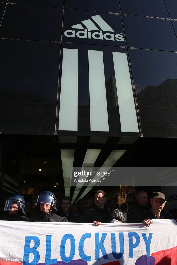 Some hundreds of Blockupy activists gather out front of the Apple and Adidas stores in Frankfurt to protest the bad conditions employees work under on May 16, 2014. Protestors running towards Zeil street, famous for shopping stores, cause tension with the police.