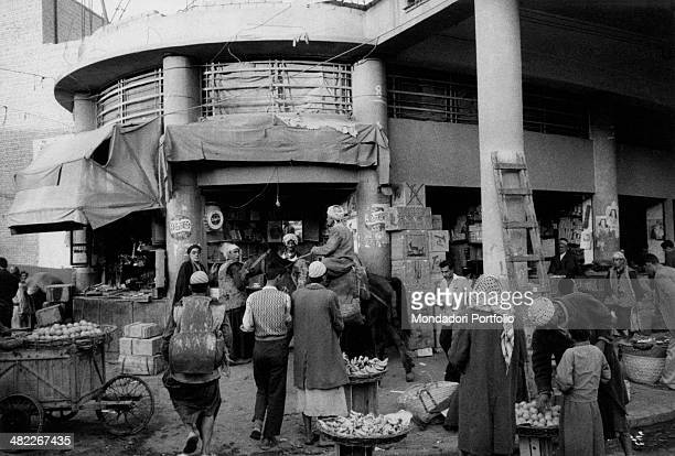 Some Iraqi people selling fruits and eggs in a market near Barzan Baghdad December 1956