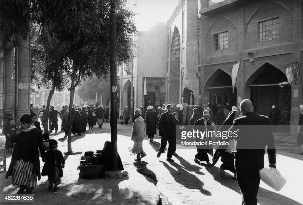Some Iraqi people walking in a street near the Husayn Mosque in the Holy City Karbala December 1956