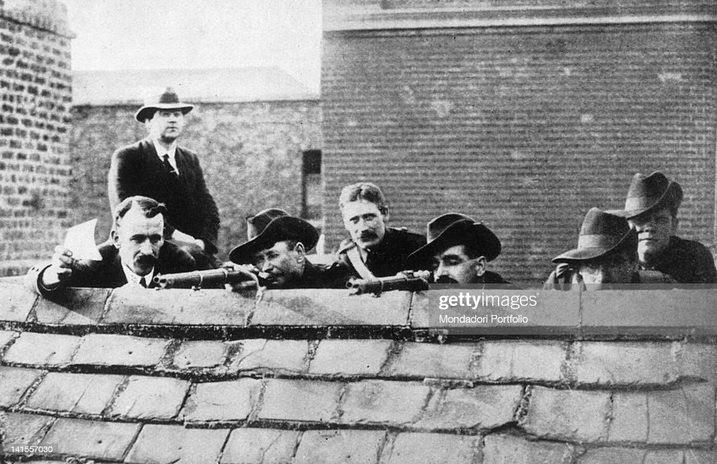 Some Irish rebels lying in wait on a roof getting ready to fire during the Easter Rising Ireland 1916