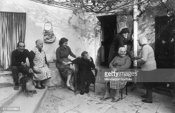 Some islanders posing with 92yearsold aunt Lucia which is the oldest people in the village Island of Gorgona 1970s