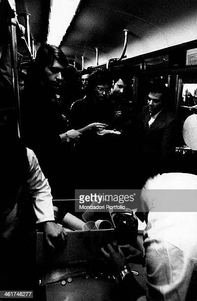 Some Italian accountants celebrating the Zapp's Club birth by giving a reception on a tram Milan 1971