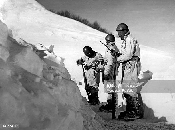 Some Italian Alpine soldiers relieving their comrades in an outpost in the snow Greece January 1941