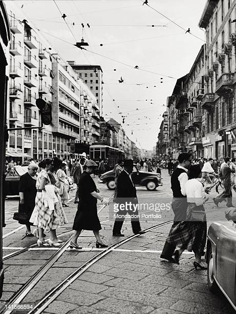 Some Italian people crossing Corso Buenos Aires near the tram's railway track Milan 1950s