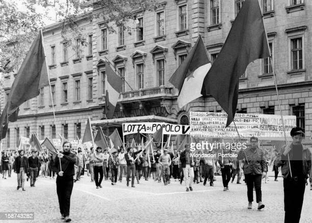 Some Italian young demonstrators of extraparliamentary left marching with banners and flags in the streets of the city Among them Italo Saugo Trento...