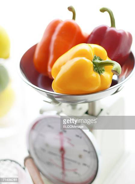 Some kinds of bell pepper on kitchen scale