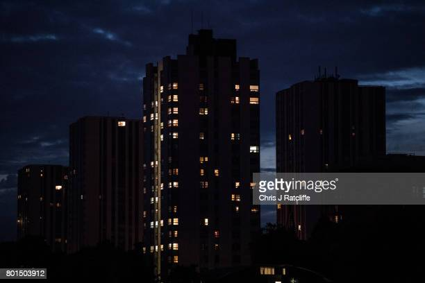 Some lights can be seen on in apartments on the Chalcots Estate as some residents still refuse to leave their properties after being urged to on June...