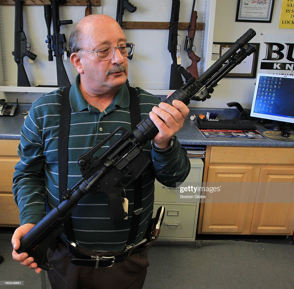 Some Massachusetts gun retailers are struggling to keep their racks stocked as manufactures meet a skyrocketing demand. Ted Oven, owner of Northeast Trading Co., Inc., holds a Del -Ton DTI -15 Sporting Rifle that is for sale.