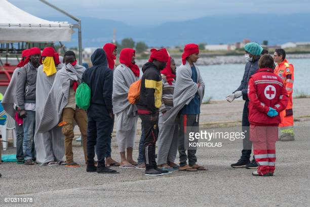 PORT CORIGLIANO CALABRIA ITALY Some migrants and unaccompanied minors during the landing from the vessel Vos Hestia of Save The Children in the port...