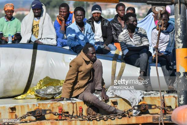 Some migrants during the landing of migrants by Turkish cargo ship Kaptan Hilmi III in port of Corigliano Calabria southern Italy The refugees...