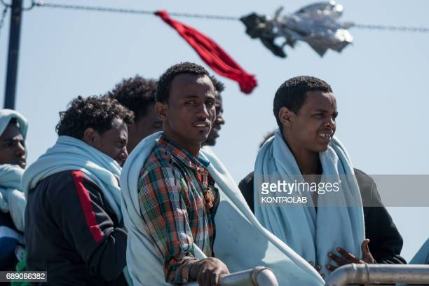Some migrants during the phase of landing migrants from Phoenix MOAS ship in the port of Crotone Calabria southern Italy 600 refugees landed from...