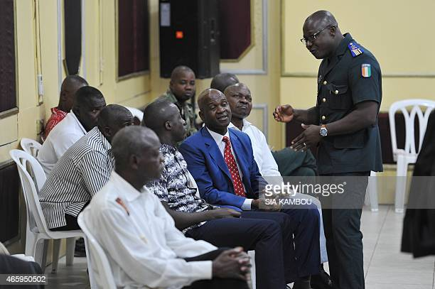 Some of 14 members of exPresident Laurent Gbagbo's security detail wait on March 12 2015 to stand trial before a military court in Abidjan over...