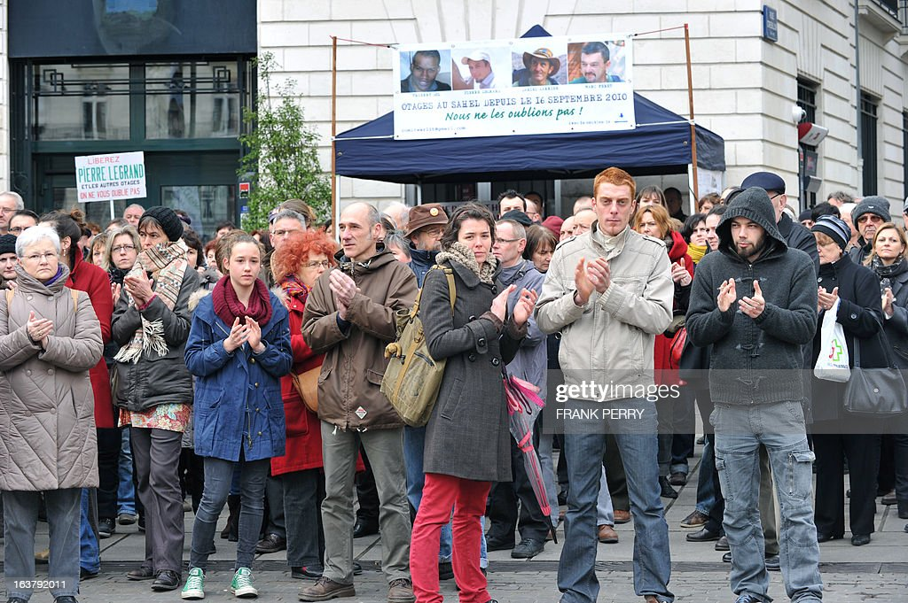 Some of 150 people gather in the western French city of Nantes to show their support for the four French hostages kidnapped by Al-Qaeda in the Islamic Maghreb (AQMI) on September 16, 2010 in Niger and held in Mali. PERRY