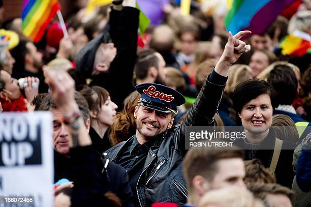 Some of 3000 people protest on April 8 2013 against Russian President Vladimir Putin's visit to Amsterdam with rainbow flags The brightly dressed...