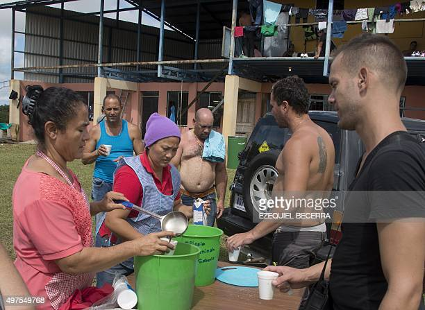 Some of a group of 150 Cubans who remain at a shelter are served coffee in La Cruz Guanacaste Costa Rica near the border with Nicaragua on November...