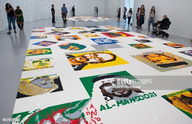 Some of Ai Weiwei's Trace at Hirshhorn exhibition is seen on June 28 2017 at the Hirshorn Museum in Washington DC The portraits laying on the floor...