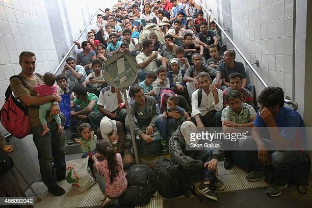 Some of approximately 190 migrants who arrived on a train from Budapest and were detained by German police wait to be initially registered by the...