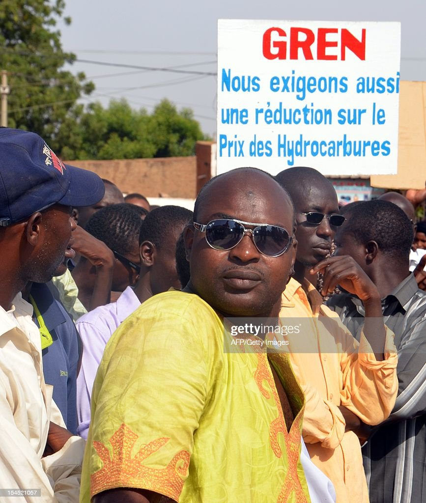Some of hundreds demonstrate on October 21, 2011 in Niamey against the high price of petrol in the west African nation, which has been producing oil since the end of last year. Niger officially became an oil producer in November 2011 with the opening of a refinery run by the state and a Chinese company near Niger's second city Zinder. Placard reads: 'We also demand a lowering of the price of gasoline.'