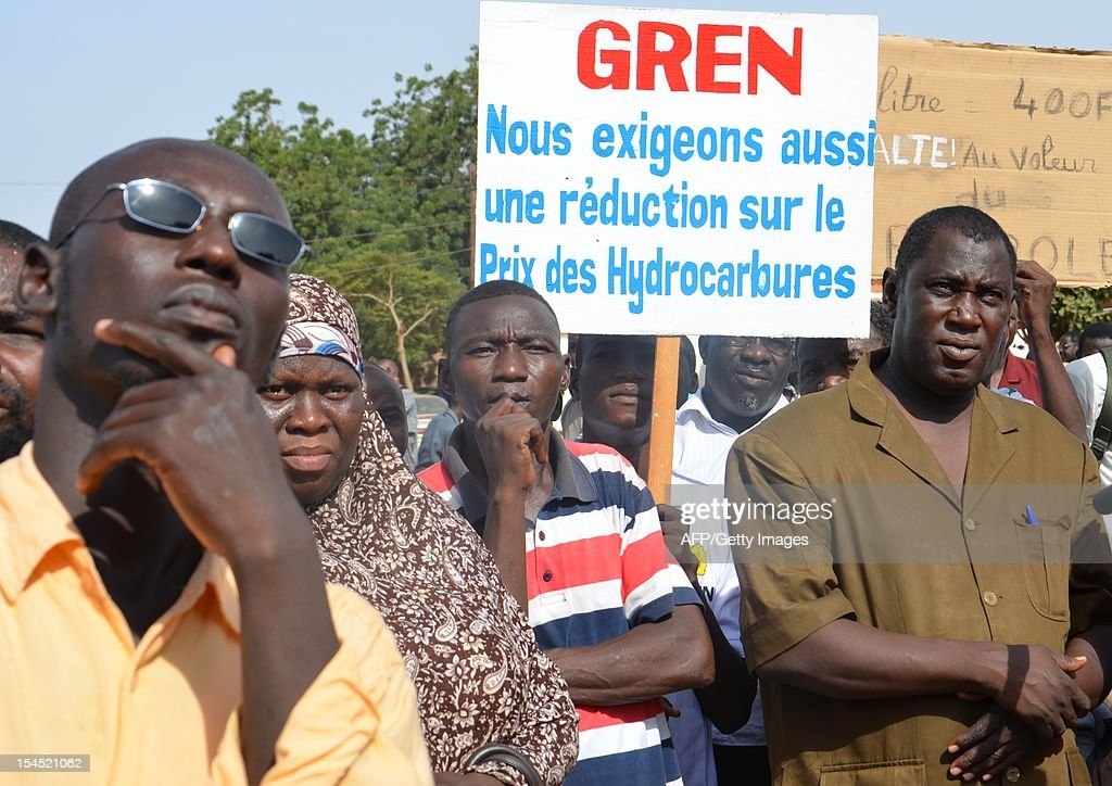 Some of hundreds demonstrate on October 21, 2011 in Niamey against the high price of petrol in the west African nation, which has been producing oil since the end of last year. Niger officially became an oil producer in November 2011 with the opening of a refinery run by the state and a Chinese company near Niger's second city Zinder. Placard reads: 'We also demand a lowering of the price of gasoline.' AFP PHOTO / BOUREIMA HAMA