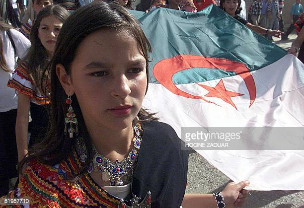 Some of tens of thousands of ethnic Berbers take part 01 November 2001 in Ighil Imoula in a peaceful protest march in the troubled Kabylia region in...