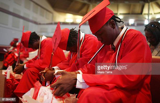 Some of the 11 students of the first and last graduating class of Livingston High School pray at their commencement June 3 2008 in New Orleans...
